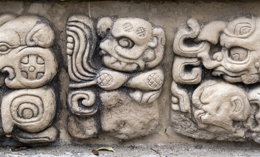 Carvings of 'demons' at Copán, Honduras