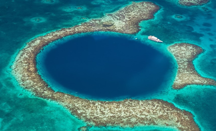 Belize's most famous natural wonder is the mysterious Blue Hole located roughly 70km south east of Belize City. © Shutterstock/Globe Guide Media Inc