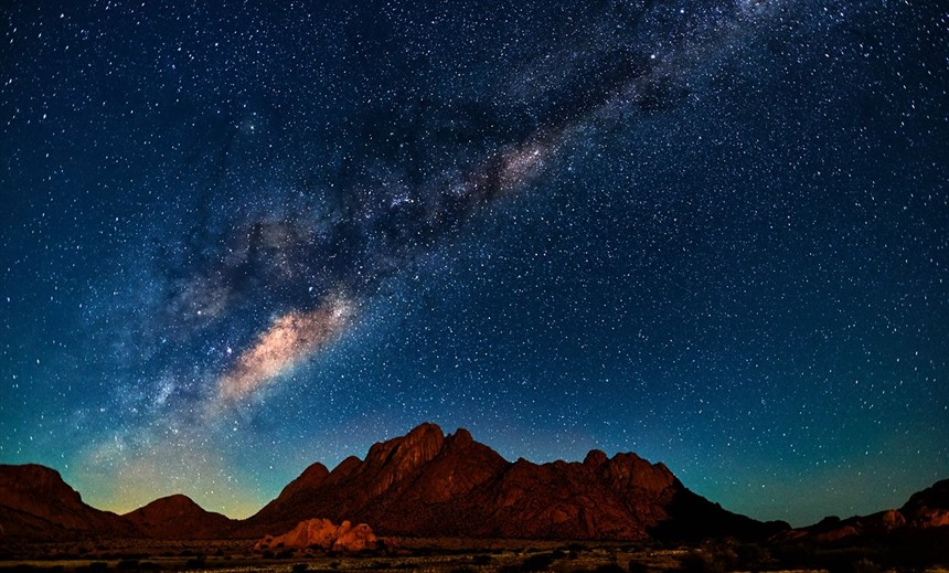 The night sky over mountains in the Spitzkoppe area. © ArCaLu / Shutterstock