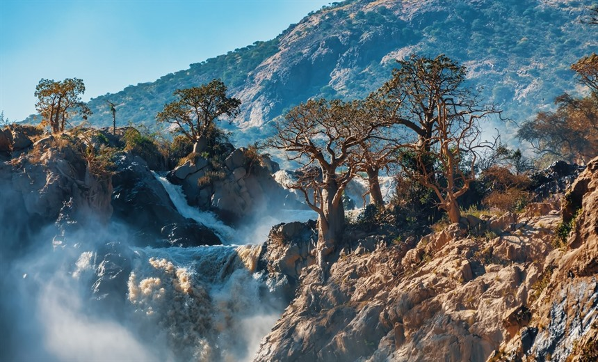 Epupa Falls lie on the Kunene River in northern Namibia on the southern Angola border. © Artush / Shutterstock