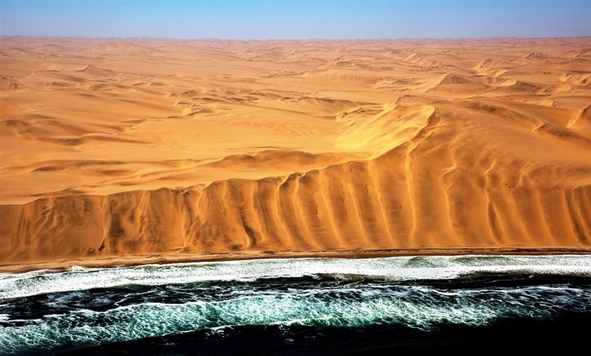 The Namib Desert meets the Atlantic Ocean at the Skeleton Coast. © Giuseppe_D'Amico / Shutterstock