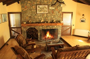 Relaxing by the fireplace at Hosteria el Puma