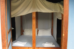 The beds are comfortable and have mosquito nets