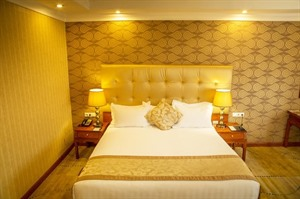 Bedroom at Jupiter International Hotel Bole