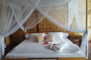 Some chalets have draped mosquito netting and traditional decor