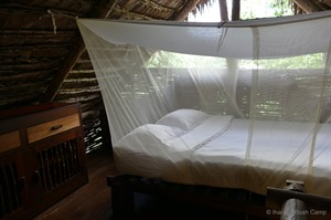 mosquito net and bed at Iharana Bush Camp