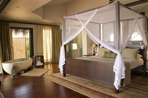 Bed and bath at Anantara Bazaruto Island Resort & Spa