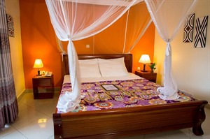 Bed with Mosquito net at Heaven Boutique Hotel