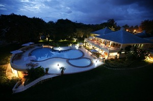 Lake Kivu Serena Hotel Pool and Hotel at night