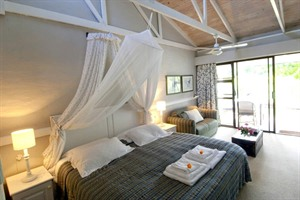 Bedroom at Bitou River Lodge