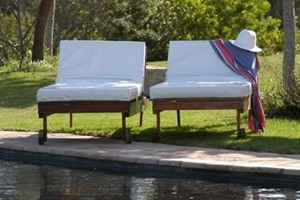 Sun loungers by pool at Bitou River Lodge