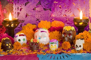 Gravestone decorations laid during the Day of the Dead